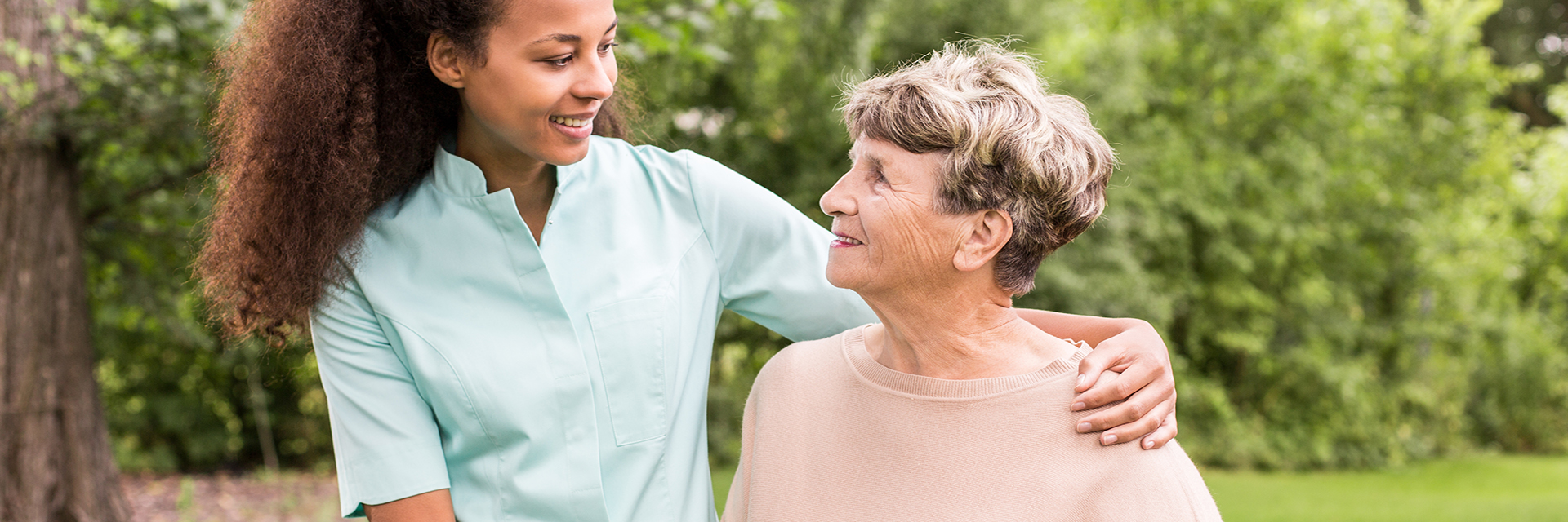 nurse outside with patient smiling at each other